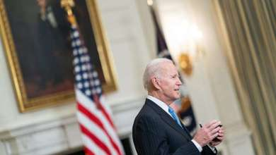 President Joe Biden talks to members of the press in the State Dining Room of the White House Tuesday