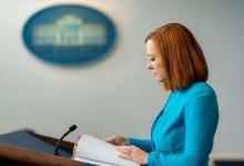 White House Press Secretary Jen Psaki pauses for a moment as she addresses reporters on Thursday