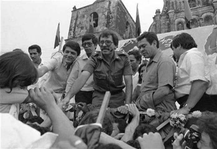 In this Oct. 28, 1984 file photo, Nicaraguan presidential candidate for the Sandinista National Liberation Front Daniel Ortega reaches out to supporters during a final campaign appearance in Leon, Nicaragua. Ortega, the current Nicaraguan president, fought against unlimited presidential reelection in his youth, when the country was ruled by the Somoza dictatorship. On Tuesday, Dec. 10, 2013. Nicaraguan lawmakers, in the first of two votes, approved Ortega's request to remove presidential term limits. (AP Photo/Jeff Robbins, File)