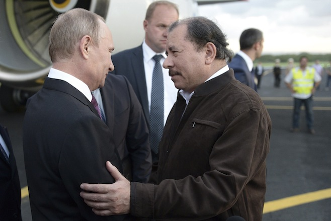 Aleksey Nikolskyi / RIA Novosti / ReutersRussia's President Vladimir Putin (L) speaks to Nicaragua's President Daniel Ortega after arriving at the international airport in Managua.