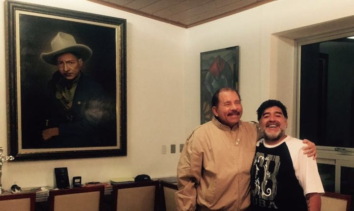 Nicaragua president, Daniel Ortega (L), hugging Diego Armando Maradona.