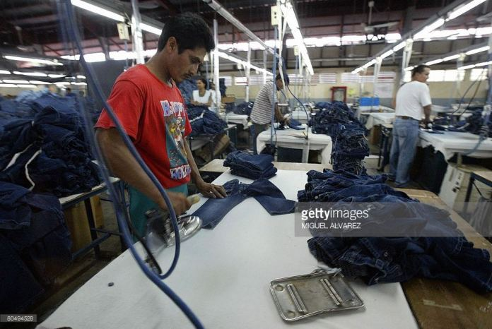 An employee irons at a textile mill in the Industrial Park in the Free Zone in Managua. Getty Images