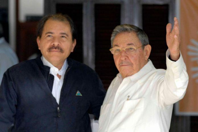 Archives photo of  Daniel Ortega (left) and Raul Castro (right(