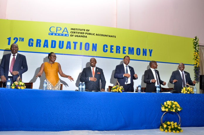 ICPAU Council members and other dignatories jubilating with the graduates