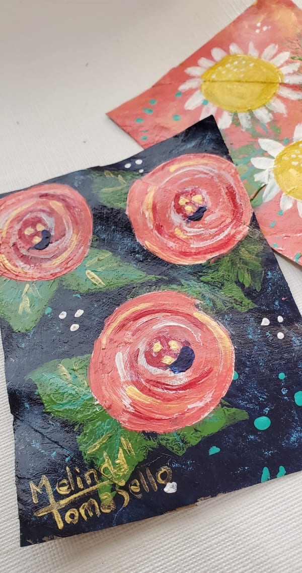 painted flowers on cardboard squares