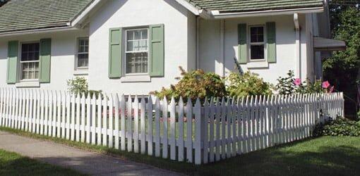 White picket fence around cottage.
