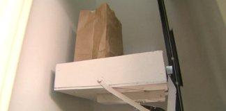 Garage door dumbwaiter being used to carry groceries upstairs.