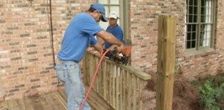 Using a nail gun to attach handrail spindles to rails