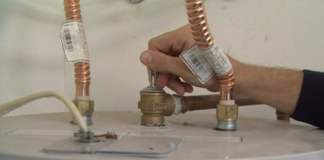 Opening pressure relief valve on top of water heater