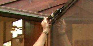 Adjusting a pneumatic closer on a storm door.