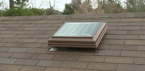 Solar powered attic exhaust vent fan mounted on roof.