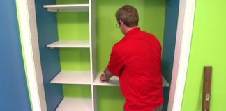 Allen Lyle installing DIY closet storage and shelving.