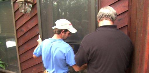 Installing a storm door.