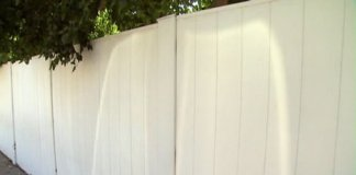 Composite fence made from recycled plastic
