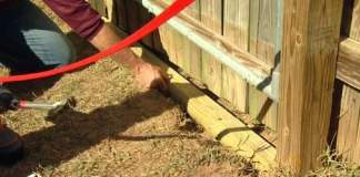Installing landscape timber under gate