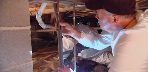 Wrapping exposed pipes with foam pipe insulation.