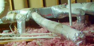 Heating and cooling HVAC ductwork in attic