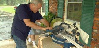 Danny Lipford cutting crown molding on power miter saw