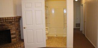 Wheelchair accessible door leading into bathroom.
