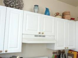 White frameless kitchen hanging cabinets with full overlay doors.