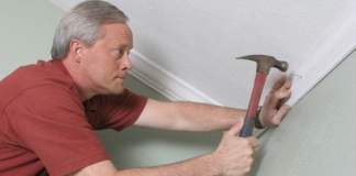Danny Lipford installing crown molding in a room.