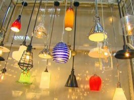 Wide range of pendant lights hanging in store.