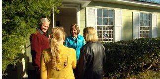 Danny Lipford, daughter Chelsea, and wife Sharon meet with Realtor at house.
