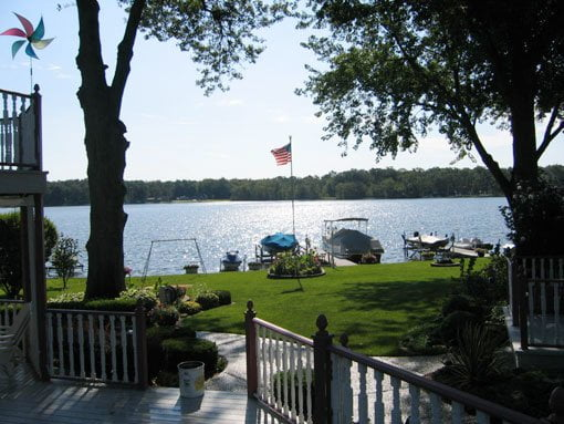 Winning photo of lawn leading to lake with boats in the Great American View Contest.