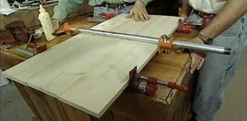 Using pipe clamps to glue boards together.