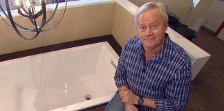Danny Lipford in bathroom showroom with tub.