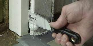 Filling water damaged rotten door jamb with wood putty filler.