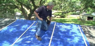 Danny Lipford demonstrating how to secure a tarp to a storm damaged roof.
