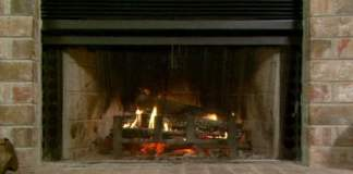 Fire in wood burning fireplace.
