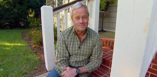 Danny Lipford sitting on porch steps.