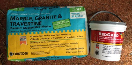 Custom Building Products mortar mix and waterproofer.