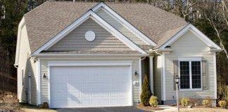 House with white garage door.