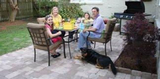 Family entertaining on DIY paver patio.