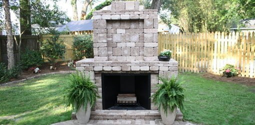 Outdoor fireplace made with Pavestone pavers.