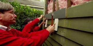 Replacing wood siding on a house.