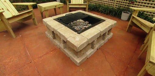 Paver fire pit on concrete patio.