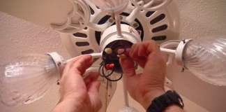 Disconnecting the wires to a ceiling fan light switch.
