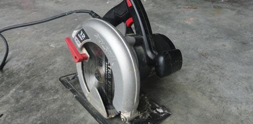 Circular saw sitting on concrete floor.