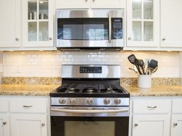 Updated kitchen with new white subway tile backsplash.
