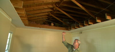Danny Lipford shows ceiling removed during renovation.