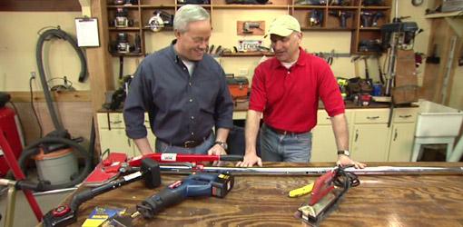 Danny Lipford and Joe Truini examining  flooring installation tools.