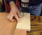 Drilling holes for handles in cabinet door using drilling jig
