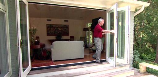 Danny Lipford opening folding patio doors.