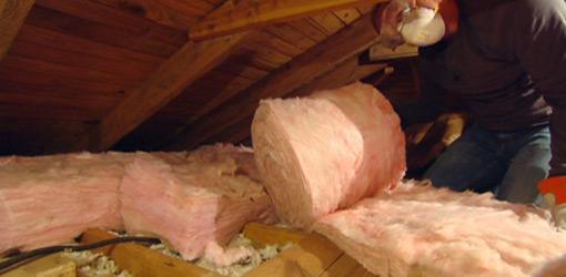 Adding fiberglass insulation to an attic