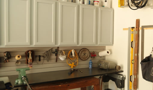 Workbench with hanging cabinets.