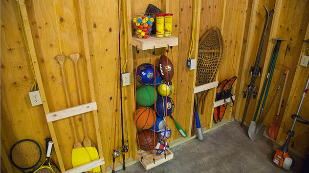 Open stud spaces in the garage provide lots of opportunities for storage.